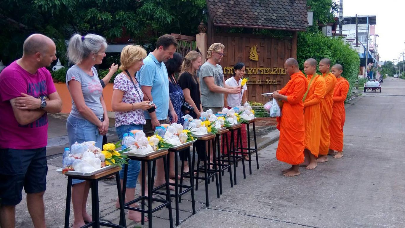 Giving food offerings to Buddhist monks